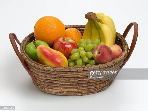 Basket of fruit against white background