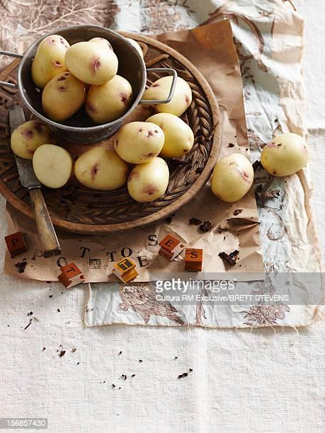 Basket of potatoes on table