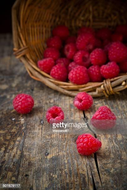 Basket of raspberries on wooden table