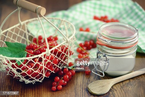 basket of red currant and glass sugar on table