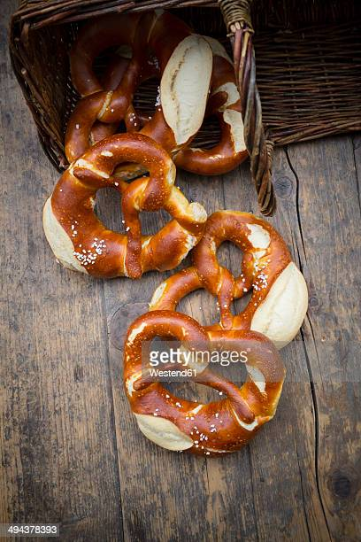 Basket of salted pretzels on wooden table