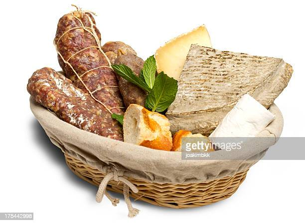 Basket of sausages and bread isolated on white