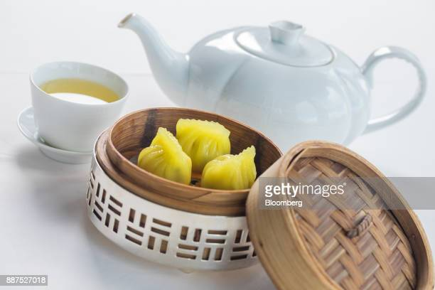 A basket of steamed chicken and Japanese tofu dumplings with superior pottage is arranged for a photograph at Lung King Heen restaurant at the Four...