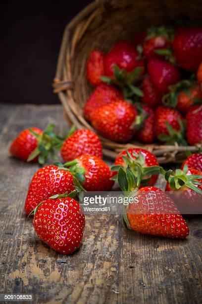 Basket of strawberries on dark wood