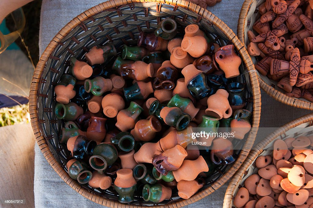 Basket with tiny clay pots : Stock Photo