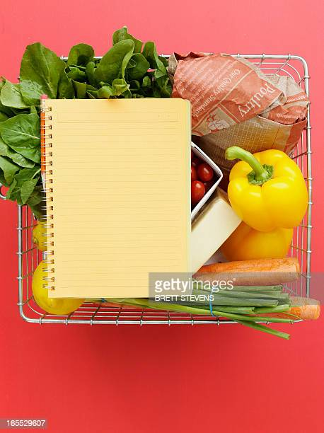 Basket with vegetables and notebook