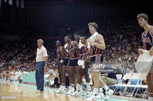 1984 Summer Olympics USA coach Bobby Knight Sam Perkins Wayman Tisdale Patrick Ewing Alvin Robertson Chris Mullin and Steve Alford on sidelines...