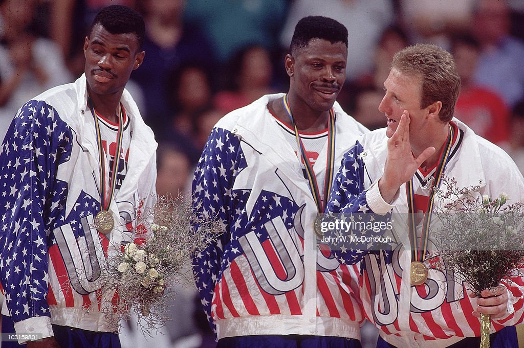 1992 Summer Olympics USA David Robinson Patrick Ewing and Larry Bird victorious on medal stand after winning Men's Gold Medal Game vs Croatia at...