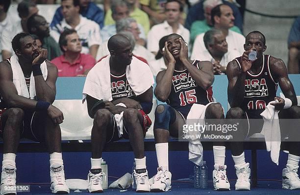 1992 Summer Olympics View of USA Karl Malone Michael Jordan Magic Johnson and Clyde Drexler during game vs Puerto Rico Dream Team Badalona Spain...