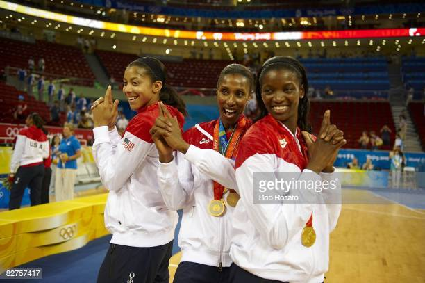 2008 Summer Olympics USA Candace Parker Lisa Leslie and Delisha MiltonJones victorious with gold medals after game vs Australia during Women's Gold...