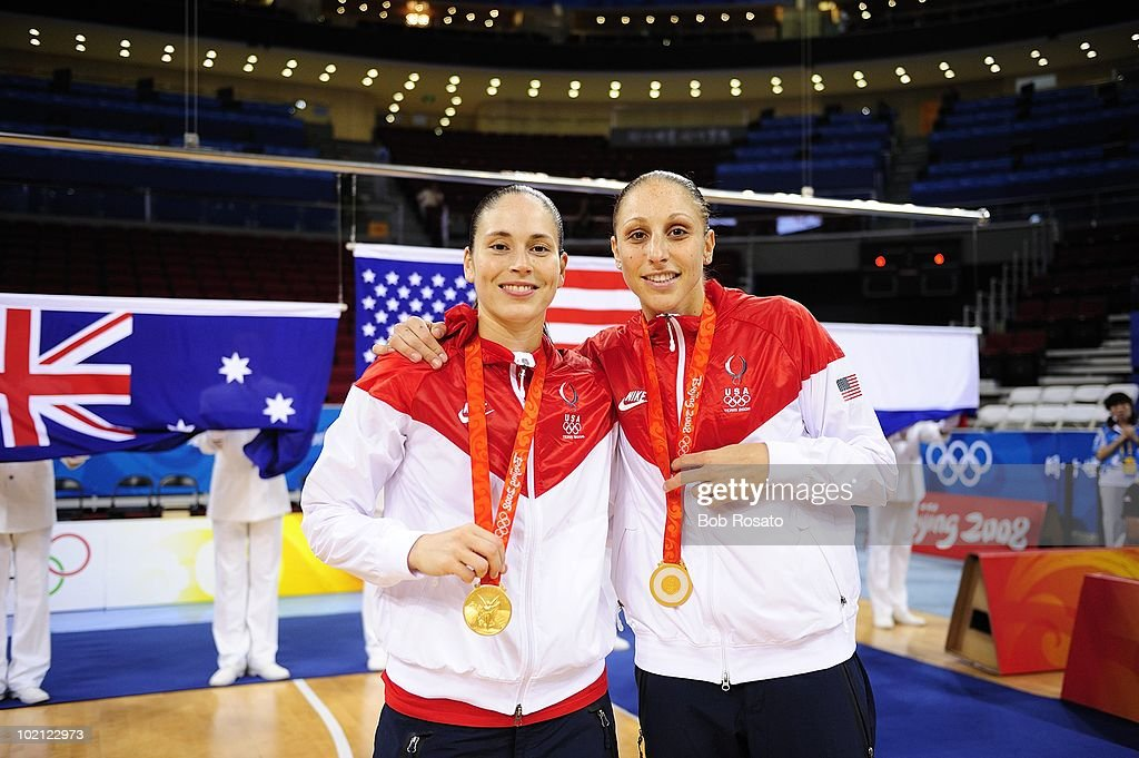 USA Sue Bird (6) and Diana Taurasi (12) victorious with medal after winning Women's Gold Medal Game vs Australia at Olympic Basketball Gymnasium in Wukesong Culture and Sports Center. Beijing, China 8/23/2008
