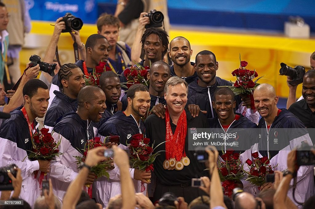 USA team and Mike D'Antoni victorious with gold medals after game vs Spain during Men's Final at Olympic Basketball Gymnasium in Wukesong Culture and Sports Center. Beijing, China 8/24/2008