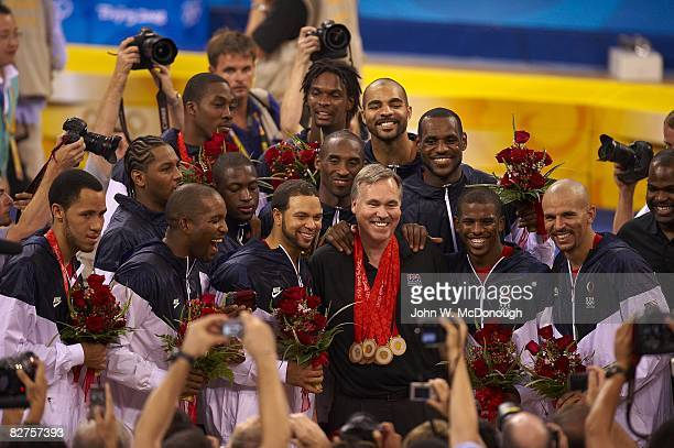 2008 Summer Olympics USA team and Mike D'Antoni victorious with gold medals after game vs Spain during Men's Final at Olympic Basketball Gymnasium in...
