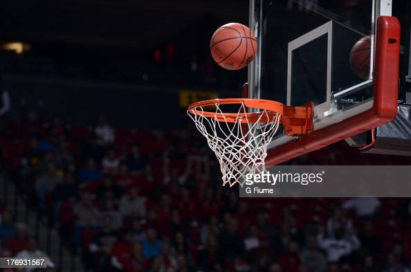 A basketball above the rim during the second round of the NIT Basketball Tournament between the Maryland Terrapins and the Denver Pioneers at the...