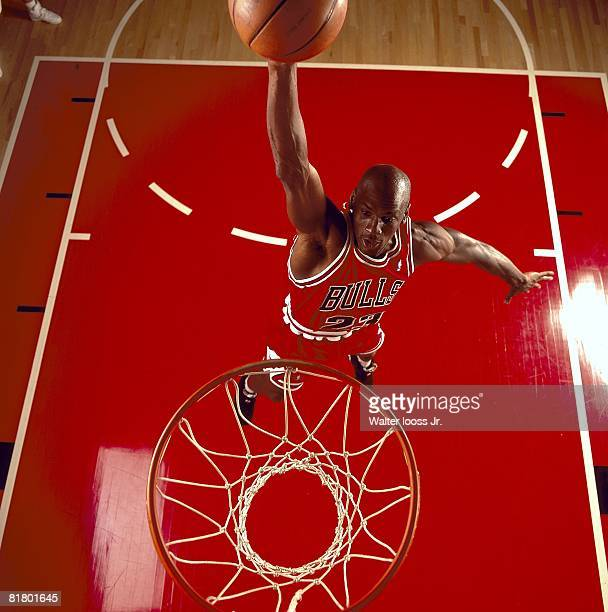 Basketball Aerial portrait of Chicago Bulls Michael Jordan in action dunk