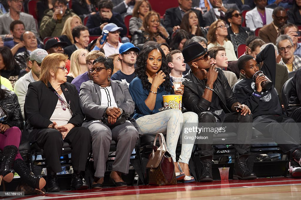 View of celebrity singer Ne-Yo and girlfriend Monyetta Shaw (L) seated courtside during game at Toyota Center. Greg Nelson F58 )