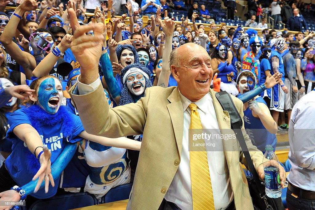 ESPN basketball analyst Dick Vitale poses for a photo with Cameron Crazies of the Duke Blue Devils prior to a game against the North Carolina Tar Heels at Cameron Indoor Stadium on February 13, 2013 in Durham, North Carolina. Duke defeated North Carolina 73-68.