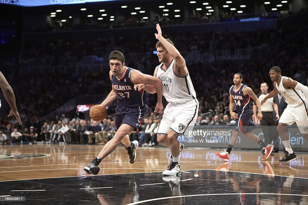 Atlanta Hawks Zaza Pachulia (27) in action vs Brooklyn Nets Brook Lopez (11) at Barclays Center. Erick W. Rasco F206 )
