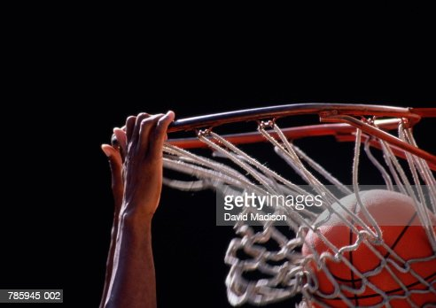 Basketball, ball being dunked through basket, close up