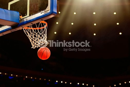 Basketball basket with ball going through net