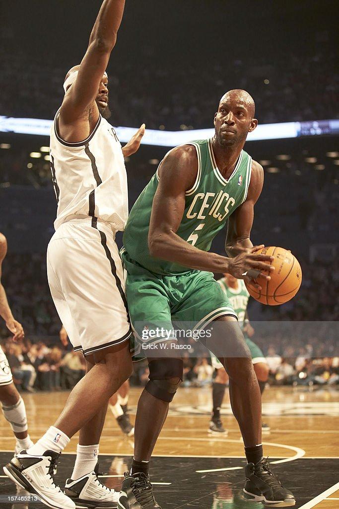 Boston Celtics Kevin Garnett (5) in action vs Brooklyn Nets Reggie Evans (30) at Barclays Center. Erick W. Rasco F241 )