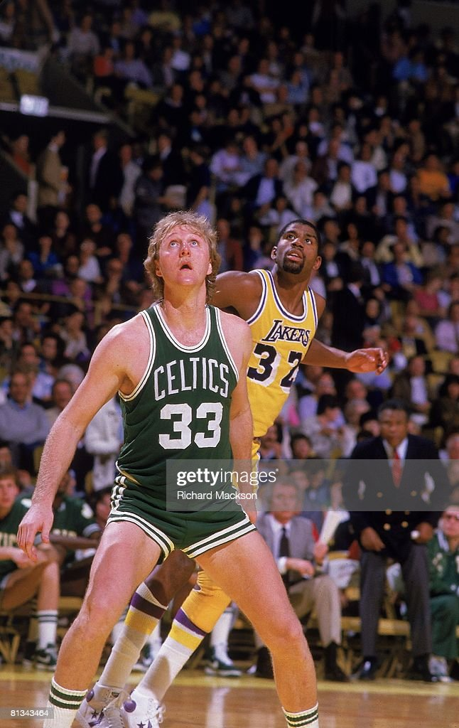 Boston Celtics Larry Bird (33) in action, boxing out vs Los Angeles Lakers Magic Johnson (32), Los Angeles, CA 2/24/1984