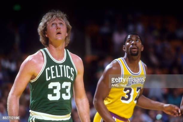 Boston Celtics Larry Bird with Los Angeles Lakers Magic Johnson during game at The Forum Inglewood CA CREDIT Andy Hayt