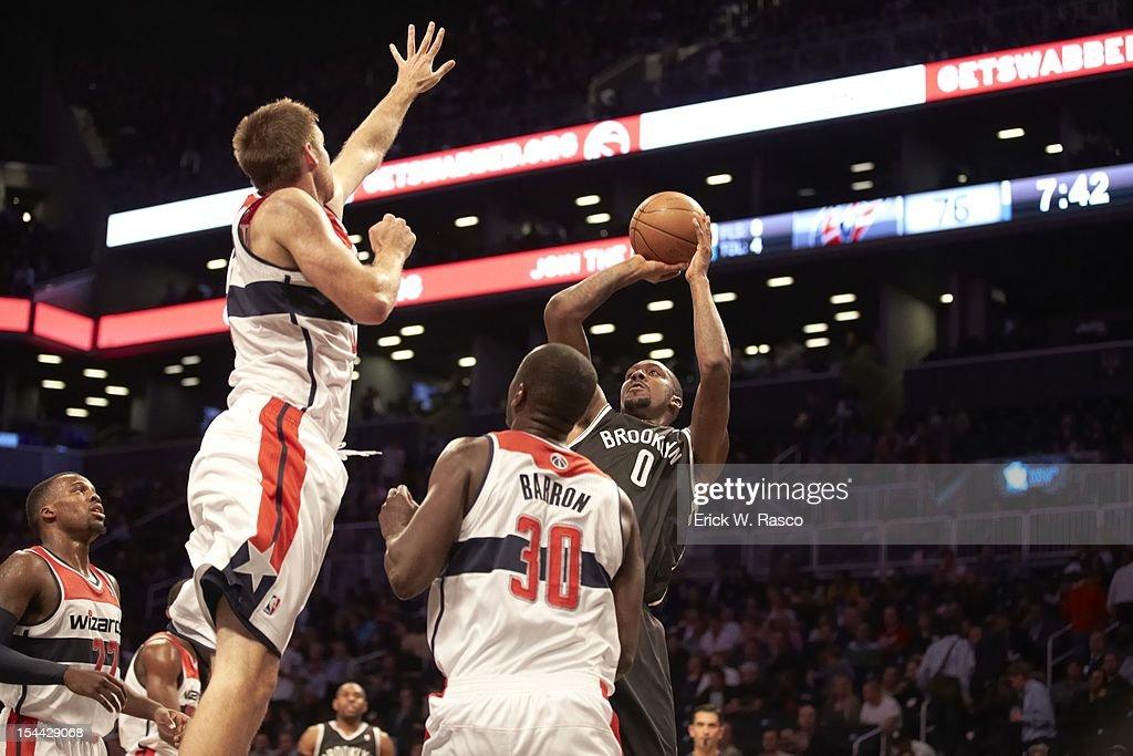 Brooklyn Nets Andray Blatche (0) in action, shot vs Washington Wizards Earl Barron (30) during preseason game at Barclays Center. Erick W. Rasco F305 )