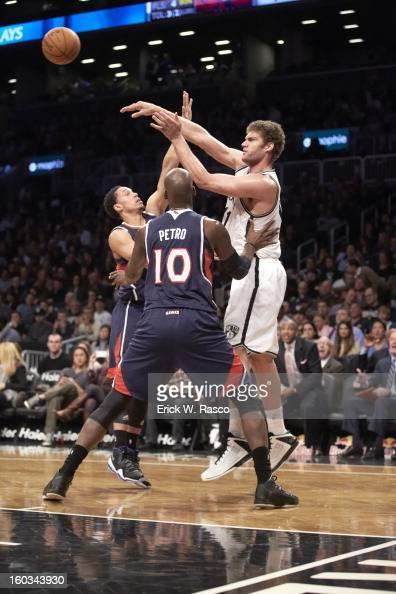 Brooklyn Nets Brook Lopez in action passing vs Atlanta Hawks at Barclays Center Brooklyn NY CREDIT Erick W Rasco