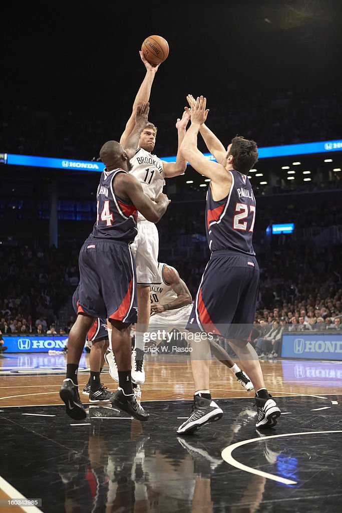 Brooklyn Nets Brook Lopez (11) in action vs Atlanta Hawks Zaza Pachulia (27) and Ivan Johnson (44) at Barclays Center. Erick W. Rasco F816 )