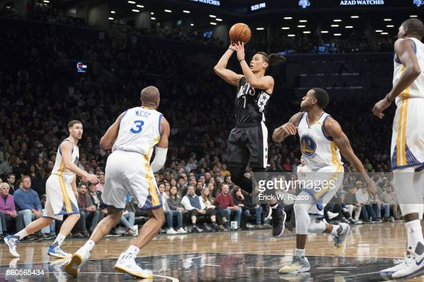 Brooklyn Nets Jeremy Lin in action shooting vs Golden State Warriors Andre Iguodala at Barclays Center Brooklyn NY CREDIT Erick W Rasco