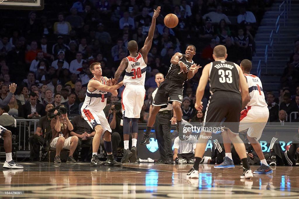 Brooklyn Nets Joe Johnson (7) in action, pass to Mirza Teletovic (33) vs Washington Wizards Earl Barron (30) during preseason game at Barclays Center. Erick W. Rasco F259 )