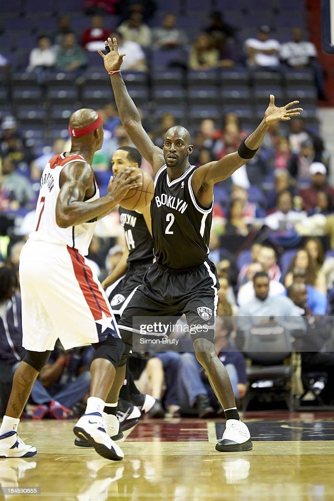 Brooklyn Nets Kevin Garnett (2) in action, defense vs Washington Wizards Al Harrington (7) during preseason game at Verizon Center. Simon Bruty F518 )
