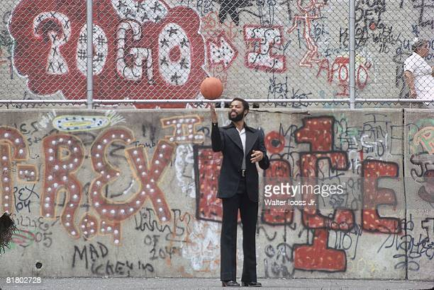Basketball Casual portrait of New York Knicks Walt Clyde Frazier in front of wall with graffiti New York City NY 1/1/1970