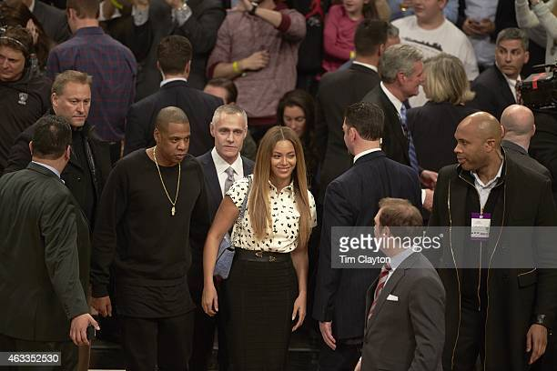 Celebrity rapper JayZ and his wife singer Beyonce on court before Cleveland Cavaliers vs Brooklyn Nets game at Barclays Center Brooklyn NY 12/8/2014...