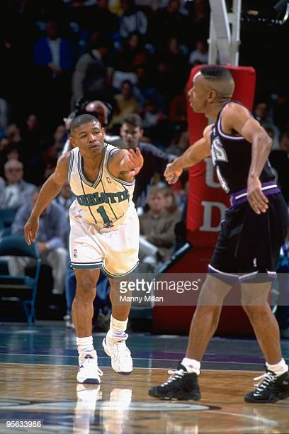 Charlotte Hornets Muggsy Bogues shaking hands with Sacramento Kings Spud Webb before game Charlotte NC 2/22/1995 CREDIT Manny Millan
