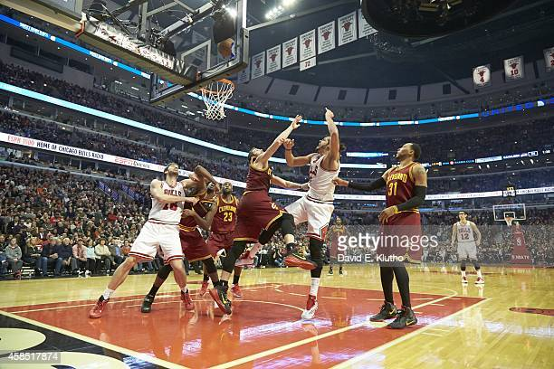 Chicago Bulls Joakim Noah in action vs Cleveland Cavaliers Kevin Love at United Center Chicago IL CREDIT David E Klutho
