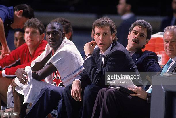 Chicago Bulls Michael Jordan and head coach Doug Collins on sidelines with assistant coach Phil Jackson during game vs Charlotte Hornets Charlotte NC...