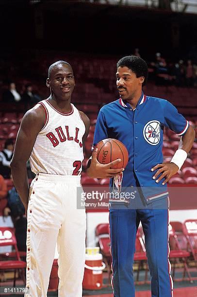 Basketball Chicago Bulls Michael Jordan and Philadelphia 76ers Julius Erving during warmups before game Chicago IL