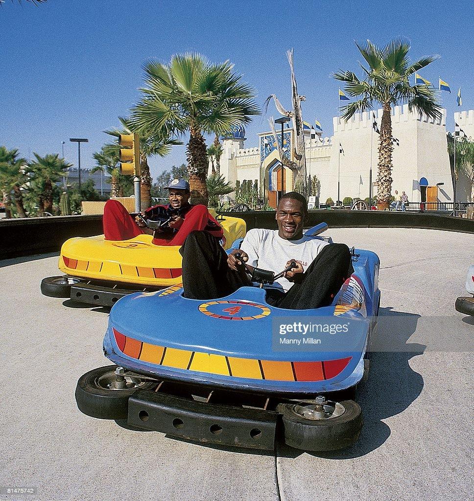 Chicago Bulls Michael Jordan with Rod Higgins driving Go Karts, Phoenix, AZ