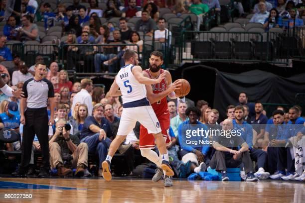 Chicago Bulls Nikola Mirotic in action vs Dallas Mavericks JJ Barea during preseason game at American Airlines Center Dallas TX CREDIT Greg Nelson