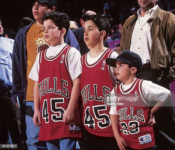 Basketball Chicago Bulls youth fans with Michael Jordan jersey during game vs New York Knicks New York NY 3/28/1995