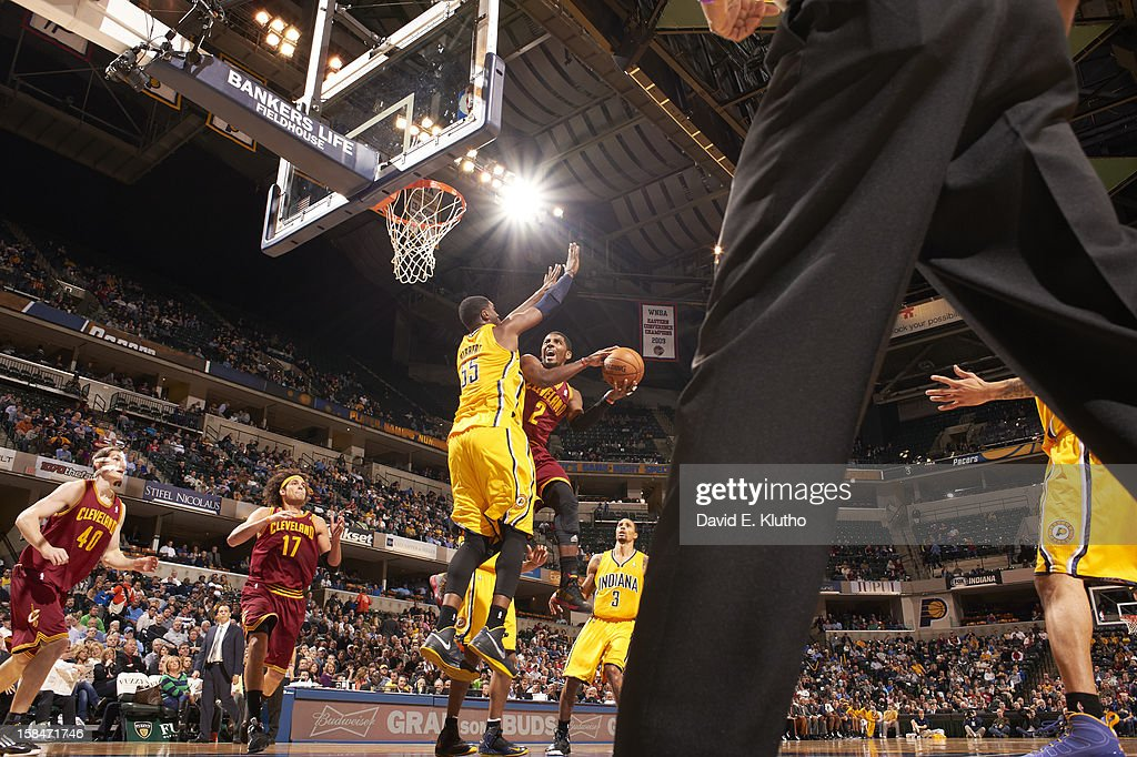 Cleveland Cavaliers Kyrie Irving (2) in action, layup vs Indiana Pacers Roy Hibbert (55) at Bankers Life Fieldhouse. David E. Klutho F66 )