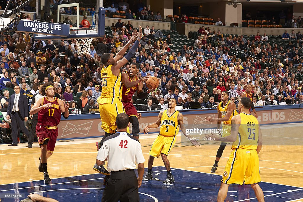 Cleveland Cavaliers Kyrie Irving (2) in action, layup vs Indiana Pacers Roy Hibbert (55) at Bankers Life Fieldhouse. David E. Klutho F85 )