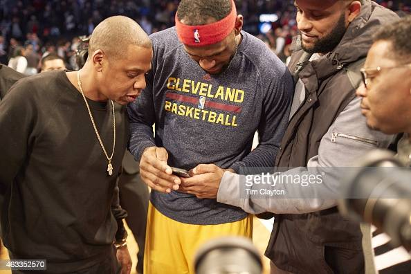 Cleveland Cavaliers LeBron James on court with celebrity rapper JayZ and New York Yankees pitcher CC Sabathia before game vs Brooklyn Nets at...