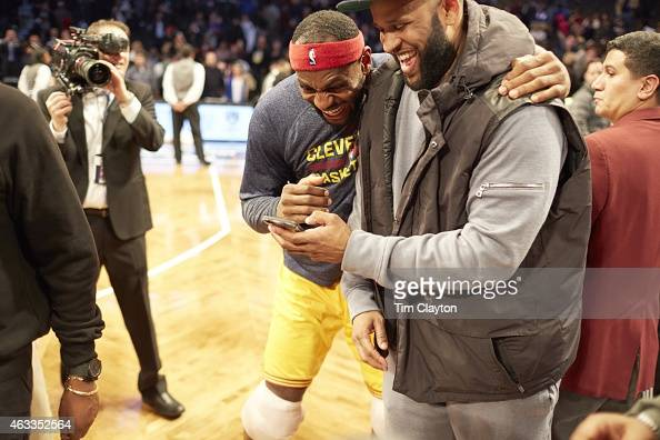 Cleveland Cavaliers LeBron James on court with New York Yankees pitcher CC Sabathia before game vs Brooklyn Nets at Barclays Center Brooklyn NY...