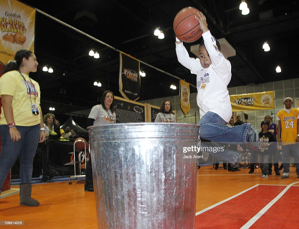 A basketball clinic participant slam dunks the ball during a drill on the Goldfish court during Jam Session presented by Adidas during All Star Weekend on February 20, 2011 in Los Angeles, California.