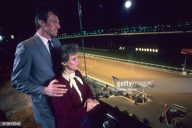 Closeup of Denver Nuggets Dan Issel and wife Cheri watching horse race during photo shoot at the Meadowlands East Rutherford NJ CREDIT Nancy Moran