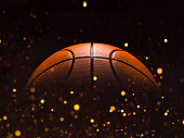 Basketball close-up on black background with bokeh, spotlights