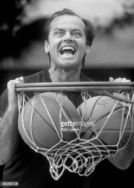 Closeup portrait of celebrity actor and Los Angeles Lakers fan Jack Nicholson dunking ball into net CREDIT Brian Lanker